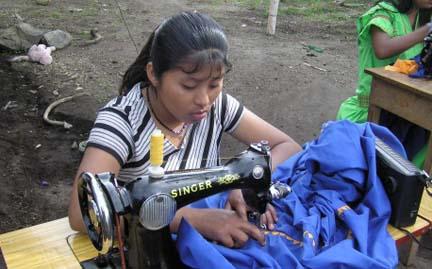 Indian dress maker working on a native enagua.