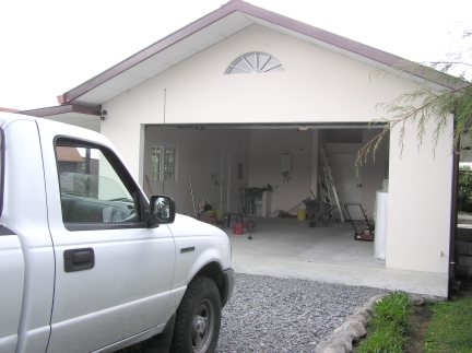 Douible garage with safe room for valuables.