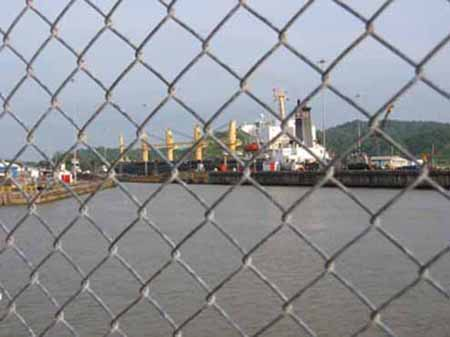 Panama Canal entertains locals, too. Many press noses to this fence to watch shipping enter the Miraflores Locks.