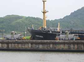 Mechanical mules haul this freighter toward the Miraflores Locks.