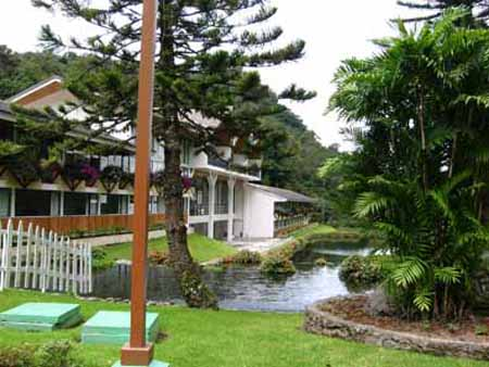 Ornamental trout ponds sit amid lush lawns in front of the Bambito Hotel.